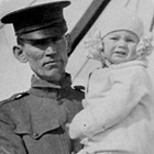 Jerry T. Allen, with 1-1/2-year-old Jerry Albert at Fort Liscum, Alaska, 1916.