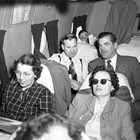 Ship of State.  Statehood group travels to Washington, D.C. in 1950 on board a DC4.  Senator Gunnard Enebreth and Bob Atwood sit behind two unidentified women.