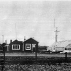 First home and greenhouse in Anchorage, 4th Avenue and A Street, 1923.