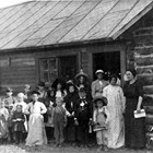 The first school in Knik, 1913.  Five of the children pictured here were Bartholf children - Marjorie, Pearl, Chester, Ralph and Edith.  May Cody was the teacher.
