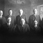 "First Anchorage City Council, 1920.  Seated, left to right: D. H. Williams, Ralph Moyer, Leopold David, Isidore ""Ike"" Bayles, and Frank Ivan Reed.  Standing, left to right: John J. Longacre, Carl Martin, J. H. Conroy, Sherman Duggan, and A. C. Craig."