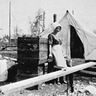 Lillie Berry in front of their tent home, 1918.