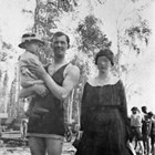 "Harry and Catherine Schultz with son, William ""Bill,"" at Lake Spenard, 1919."