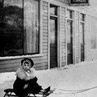 Ralph Courtnay and friend in front of Parsons Hotel, Anchorage, ca. 1920.
