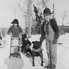 Ralph Courtnay and his dog, with Vanny Jones Courtnay and Vivian Jones on I Street, Anchorage, ca. 1917.