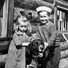 Crawford children Bertha and Leroy and dog at their home in Anchorage, 1920.