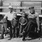 "Edward ""Ed"" Dodd, sons Robert ""Bobby"" and George, and Ed's uncle Tom Dodd at Tom's general store in Kanatak, Alaska in 1931."