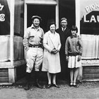 Dick Scott, Lillian Scott Dool, Burt Dool, and Doris DeHon Dool in front of the Pioneer Laundry (739 4th Avenue, Anchorage), early 1930s.