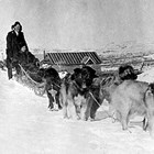 Arne and Josephine Erickson with dog team, Flat, Alaska, 1920.