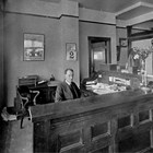 Winfield Ervin Sr. in the front office of the First National Bank of Anchorage, ca. 1930.