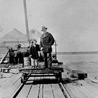 Emil Harlacher with daughter Betty at the General Fish Dock, Anchorage, 1931.
