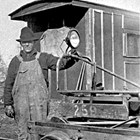 "Alaska Railroad section foreman Victor Johnson at Curry, Alaska with ""Speeder,"" ca. 1925."