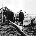 Building the Johnson family log cabin at 5th Avenue and Denali Street, Anchorage, ca. 1916.