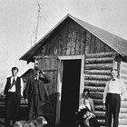 Victor Johnson, Elin Johnson, son Donald Johnson and friends at the completed home, Anchorage, 1918.