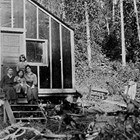 The family's cabin at Jonesville Mine Camp, Alaska, 1921. The individuals shown in the photograph are not identified.