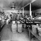 Irving Kimball in his Anchorage store, 1915.