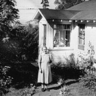 Elizabeth Landstrom in front of home, 3rd Avenue and H Street, Anchorage.