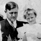 "Raymond ""Ray"" or ""R.C."" Larson with daughter Helen, ca. 1920."