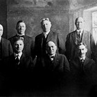 "First city council, Anchorage, 1920. Left to right: A.C. Craig, Carl Martin (city engineer), Ralph Moyer, Joseph Conroy (city clerk), Leopold David (mayor), Sherman Duggan (attorney), John L. Longacre, Isidore ""Ike"" Bayles, Frank Ivan Reed, and D.H. Williams."