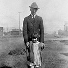 Paul Marsch and his daughter,Peggy, at 5th Avenue and K Street, Anchorage, 1925.