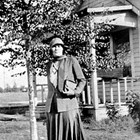 Eleanor Marsch in front of the family home, 7th Avenue and H Street, Anchorage, 1936.