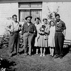 The Martin family at home, 626 D Street, Anchorage.  Left to right:  unidentified man, Carl Sr., Lucille, Dorothy, Bonnie, and Carl Jr.