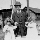 John Casey McDannel with the twins (Helen and Mary) at 4th Avenue and K Street, Anchorage, 1919.