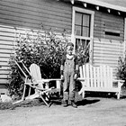 James Nelson in front of his family's first home on Government Hill in Anchorage, ca. 1940.