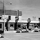 Buildings at 4th Avenue and B Street, Anchorage, shown in 1950.   This was the original site of the Lido Hotel, which burned down during World War II and was rebuilt.