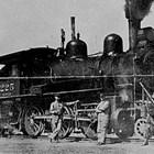 """Joe Bush"" Elms; Thomas ""Tom"" Peterkin, engineer; ""Red"" Brennan; and Adolph Young with Alaska Railroad Locomotive No. 225."
