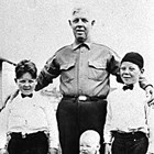 "Charles ""Charley"" Quinton with boys, ca. 1930."