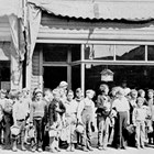 Grade school class, going out for a picnic, in front of Charles Quinton's barber shop, 1935.