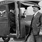 Frank Reed (standing at right) with President Warren G. Harding in the Anchorage Hotel bus, 1923.