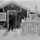 "August ""Gus"" or ""Gust"" Seaburg in front of his first Anchorage home, 4th Avenue and Eagle Street, 1925."