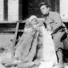 Harry and daughter Renee on her first birthday on Atka, 1912, where Kathryn was teaching.  The furs were gifts to Renee.