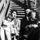 Renee and Harry Seller with younger children Betty and John on the steps of their home in Anchorage at the end of Fourth Avenue, 1927.