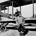 Barbara Staser, ready to board a flight with noted Alaska pilot Noel Wien, from the park strip, Anchorage, 1924.