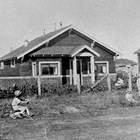 The Stoddard home at 8th Avenue and H Street, Anchorage, ca. 1925.