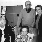 Seated, left: May Teeland Bowman, born in Ruby, 1913; center: Mabel Teeland Holbrook, born in Goldstream, 1909. Standing, center: Walter Teeland, born in Cleary City, 1907; right, Hazel Teeland Ostrander, born in Nome, 1908.