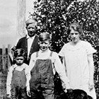 "The Tryck family, parents Oscar and Lillian (""Blanche""), rear, and sons Charles and William, 1926."