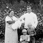 "Johanna and Jacobus ""Jim"" Van Zanten at Chickaloon with infant daughter Bertha, daughter Helen, and son John Jacob ""Jack,"" 1921."