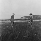 Nellie Brown with artist Sydney Laurence, possibly on shore near the Brown's homestead near Green Lake, now on the Elmendorf Air Force Base bordering Anchorage. 1920s.