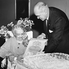 "Orah Dee Clark receiving the Cook Inlet Historical Society ""Scroll of Honor"" on her eighty-seventh birthday in 1962 from Society president Robert B. Clifton.  The Scroll commemorated her distinguished service to Alaska and to Anchorage."