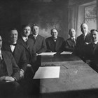 The first city council after incorporation, 1920, together with the city's clerk, attorney, and engineer.  Michael Conroy is fourth from the left.  Conroy was city clerk, the highest paid city employee with wide-ranging responsibilities.  Mayor Leopold David is in the center of the photograph.