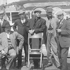 "Members of the so-called ""floating court"" of the U.S. District Court, Third Judicial Division, about 1910.  Green is sitting in the front row on the left.  As assistant district attorney based in Seward, Green was required to travel by ship to remote villages along southcentral Alaska's Pacific coast down into the Aleutians."