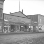 A view of Daniel O'Connell Kennedy Jr.'s post-1934 clothing store, located on the south side of Fourth Avenue, several doors west of the hardware store owned by his brother George.