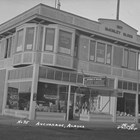 Kennedy Hardware Company on the south side of Fourth Avenue, several buildings east of where George and John's brother Dan moved Kennedy Clothing after 1934.  George Kennedy operated the hardware store with his older brother, John.