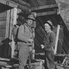 Colonel Frederick Mears (left) and fellow Alaskan Engineering Commission Commissioner Thomas W. Riggs, Jr. prepare to go hunting along the Alaska Railroad.  Mears enjoyed hunting and fishing. Riggs served as territorial governor of Alaska from 1918-1921).