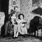 "Bert and Nona Weeda with their son, Bert, in their well-appointed Anchorage home, ca. 1935.  Burt Weeda was the brother of Luther ""L.J."" or ""Osky"" Weeda."