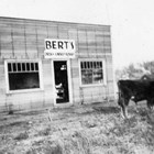 "Bert's Drug Store branch store in Palmer, Alaska, which was built by brothers Bert and ""L.J."" ""Osky"" Weeda in 1935, anticipating an increase in business because of the arrival of the Matanuska Colonists.  The picture was taken by Henrietta (""Hank"") Marsden, who noted in the photograph album ""that wasn't Osky"" in front."
